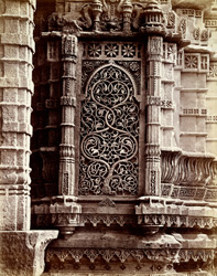 Close view of carved stone niche at the base of the minaret of the Nagina Masjid, Champaner 1861